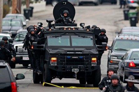 Police patrol through a neighborhood in Watertown while searching for Dzhokar Tsarnaev. (Charles Krupa/Associated Press)